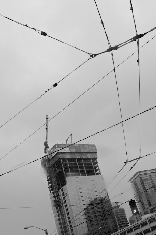 skyscraper construction and bus wires